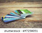 credit card on wooden... | Shutterstock . vector #697258051