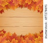 fall leaves border on top and... | Shutterstock .eps vector #697278691