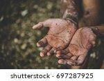 soft focus.hands poor child... | Shutterstock . vector #697287925
