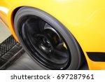 yellow orange sports car on a... | Shutterstock . vector #697287961