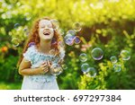 laughing curly girl with soup... | Shutterstock . vector #697297384