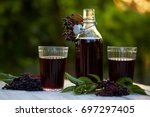 glasses of fresh elderberry... | Shutterstock . vector #697297405