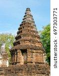 ancient pagoda at wat chedi... | Shutterstock . vector #697303771
