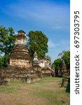 ancient pagoda at wat chedi... | Shutterstock . vector #697303795