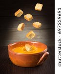 croutons falling into a... | Shutterstock . vector #697329691