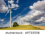 Eolic turbines, green field and clean energy concept - stock photo