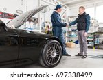 sports car in a workshop | Shutterstock . vector #697338499