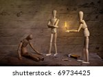 homeless dolls warming hand on fire with sick companion - stock photo