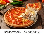 american pizza with pepperoni ... | Shutterstock . vector #697347319