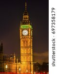 Small photo of Big Ben Tower Night Houses of Parliament Westminster London England. Named after the Bell in the Tower. Has kept exact time since 1859.
