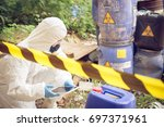 Asian scientist wear Chemical protection suit check danger chemical,working at dangerous zone - stock photo