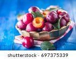plums. fresh juicy plums in a... | Shutterstock . vector #697375339