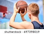male playing basketball outdoor | Shutterstock . vector #697398019