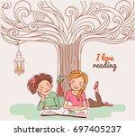 cute girls reading a book under ...   Shutterstock .eps vector #697405237