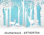 deer standing in forest. nature ... | Shutterstock .eps vector #697409704