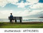 Girl Sitting On Park Bench...