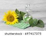 sunflower seeds and oil | Shutterstock . vector #697417375
