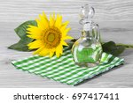 sunflower seeds and oil | Shutterstock . vector #697417411