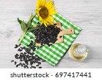 sunflower seeds and oil | Shutterstock . vector #697417441