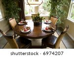 decorated kitchen table in a... | Shutterstock . vector #6974207