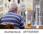 BRATISLAVA, SLOVAKIA - August 12, 2017: An old man in retirement age sitting outside with his mug with beer - stock photo