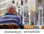 BRATISLAVA, SLOVAKIA - August 12, 2017: An old man in retirement age sitting thoughtfully on an empty table outside - stock photo