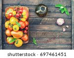 colorful organic tomatoes in... | Shutterstock . vector #697461451