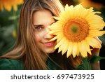 beautiful young blonde girl in... | Shutterstock . vector #697473925