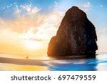 sunset on the beautiful beach... | Shutterstock . vector #697479559