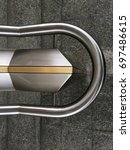 Small photo of Abstract Picture of handrail steal gold sideways
