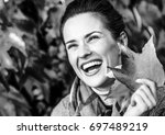 smiling young woman with autumn ...   Shutterstock . vector #697489219