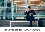 business traveler talking on... | Shutterstock . vector #697490491