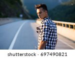 beautiful young male posing on... | Shutterstock . vector #697490821