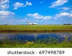 plane takes off  sky  meadow... | Shutterstock . vector #697498789
