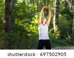 young fitness model stretching... | Shutterstock . vector #697502905