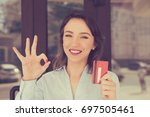 toothy smile woman holding... | Shutterstock . vector #697505461