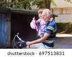 Grandpa Riding Bicycle With...