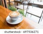 a white cup of hot latte art... | Shutterstock . vector #697536271
