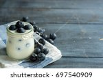 berries yogurt   yogurt | Shutterstock . vector #697540909