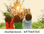 children show hand with light... | Shutterstock . vector #697564765