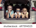 happy brother and his two... | Shutterstock . vector #697594525