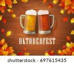 oktoberfest leaves banner.... | Shutterstock .eps vector #697615435