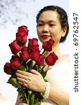 young woman with red roses in... | Shutterstock . vector #69762547