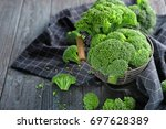metal basket with fresh green... | Shutterstock . vector #697628389