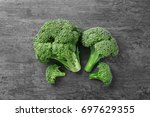 fresh green broccoli on grey... | Shutterstock . vector #697629355