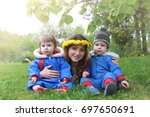 young twins sitting on a green... | Shutterstock . vector #697650691