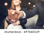 businessmen making handshake... | Shutterstock . vector #697660129