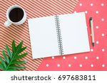 blank open notebook with a cup... | Shutterstock . vector #697683811