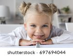 close up portrait of adorable... | Shutterstock . vector #697694044