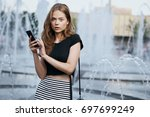 young woman with her hair in a... | Shutterstock . vector #697699249